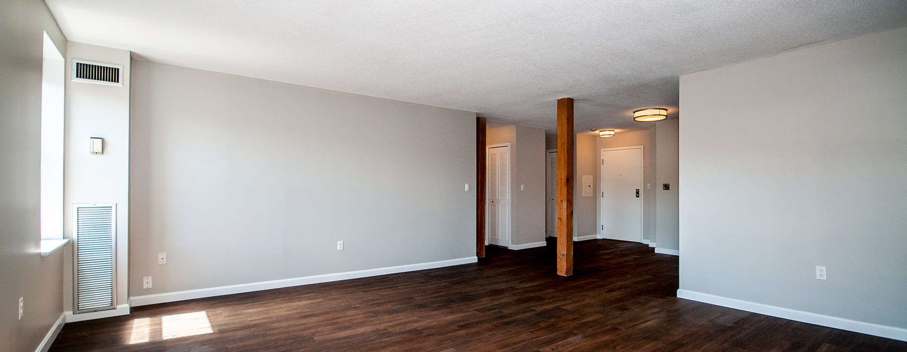 unfurnished large living room with large windows